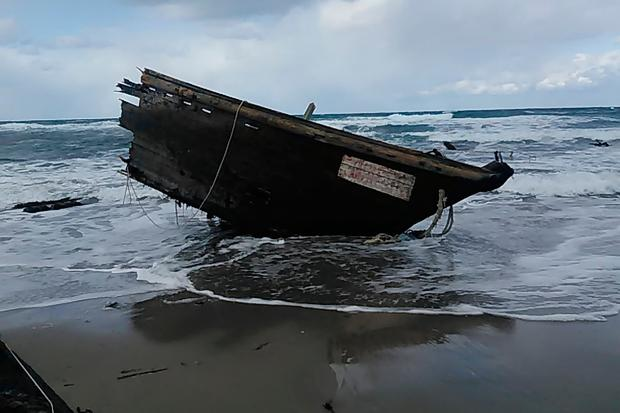 The boat, suspected of being from North Korea, beached on Sado Island, northern Japan, on which several decapitated bodies were found. Photo: AP
