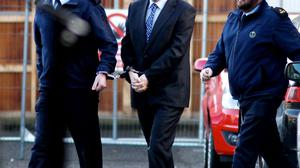 A LIFE LESS ORDINARY: Graham Dwyer after his arrest for the murder of Elaine O'Hara
