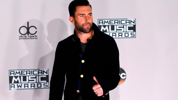 Musician Adam Levine from Maroon 5 poses in the press room at the 2016 American Music Awards