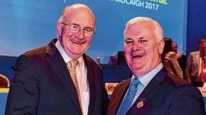 Presidential seal: Current GAA president John Horan being congratulated by predecessor Áogán Ó Fearghail in 2017 – the next man in the hot seat will have to drive change within the organisation. Photo: Ray McManus/Sportsfile