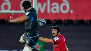 Munster fly-half Tyler Bleyendaal sees his kick charged down by Lloyd Ashley of Ospreys during Saturday night's game at the Liberty Stadium. Photo: Seb Daly/Sportsfile