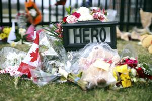 A makeshift shrine honouring RCMP Constable Heidi Stevenson is shown outside Royal Canadian Mounted Police headquarters in Dartmouth, Nova Scotia after a mass shooting (Riley Smith/AP)