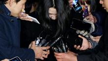 """Cho Hyun-ah (C), also known as Heather Cho, daughter of chairman of Korean Air Lines, Cho Yang-ho, is surrounded by media as she leaves for a detention facility after a court ordered her to be detained, at the Seoul Western District Prosecutor's office in this December 30, 2014 file photo. Cho, the former Korean Air Lines executive jailed for her outburst over in-flight service, known as the """"nut rage"""" case, asked for leniency during an appeal hearing on April 1, 2015 as she sought to reduce her one-year prison term. REUTERS/Kim Hong-Ji/Files"""