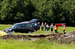 The families of Disappeared victims Seamus Wright and Kevin McKee watch as human remains are removed from bogland, near the village of Wilkinstown in Ireland June 26, 2015. More than one body has been found during a search for IRA victims who have been missing since 1972, local media reported. REUTERS/Cathal McNaughton