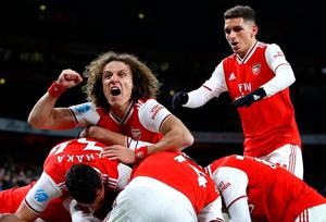 David Luiz of Arsenal celebrates his side's third goal scored by Alexandre Lacazette and team mates