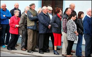 Crowds gather at White Funeral Home in Cappawhite in Tipperary to pay their respects to Cathriona White, the former girlfriend of Hollywood Actor Jim Carrey who died in Los Angeles. Pic Steve Humphreys