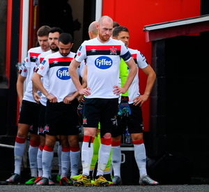 TURNING POINT: Dundalk captain Chris Shields leads out his team at Dalymount Park last week