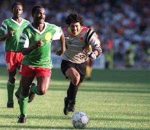 Roger Milla from Cameroon runs past Colombian goalkeeper René Higuita (r) after stealing the ball to score a goal at the 1990 World Cup. Photo: AFP