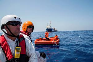 A zodiac crew from MSF's  Dignity I Search and Rescue vessel scan the sea for survivors in the area where a wooden boat carrying migrants capsized and sank earlier.  (Photo: Marta Soszynska/MSF)