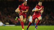 Wales player Jamie Roberts (l)  makes a break before setting up Scott Williams (r) for the second Wales try during the RBS Six Nations match between Wales and Italy at the Millennium stadium