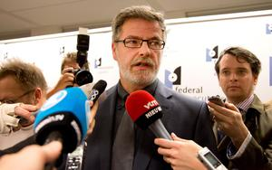 Eric Van Der Sypt, center, from the Brussels federal prosecutors office speaks with the media at police headquarters in Brussels. (AP Photo/Virginia Mayo)
