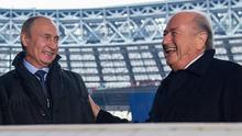 Russian President Vladimir Putin and Sepp Blatter share a joke in the Luzhniki stadium, Moscow.