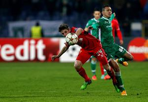 Liverpool's Joe Allen, left, is challenged by Ludogorets' Marcelinho during the Champions League Group B soccer match between Ludogorets and Liverpool at Vassil Levski stadium in Sofia, Bulgaria (AP Photo/Darko Vojinovic)