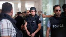 Tunisian police officers stay in the lobby of an hotel where a terrorist attack took place in the coastal town of Sousse, Tunisia, Friday June 26, 2015. A young man unfurled an umbrella and pulled out a Kalashnikov, opening fire on European sunbathers in an attack that killed at least 28 people at a Tunisian beach resort  one of three deadly attacks from Europe to the Middle East on Friday that followed a call to violence by Islamic State extremists. (AP Photo/Leila Khemissi)