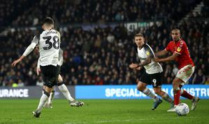 Derby County's Jason Knight scores his side's second goal of the game during the Sky Bet Championship match at Pride Park, Derby. PA Photo. Picture date: Monday December 30, 2019.