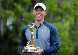 Rory McIlroy poses with the trophy after winning The 2019 Players Championship golf tournament. (AP Photo/Gerald Herbert)