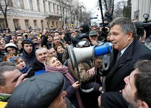 Newly elected Ukrainian interior minister Arsen Avakov (R) holds a loud-speaker as he addresses anti-government protesters outside the Ukrainian parliament building in Kiev February 22, 2014. Parliament in Ukraine elected opposition lawmaker Arsen Avakov as interior minister on Saturday until the formation of a new coalition government. Avakov takes over the powerful post after lawmakers on Friday dismissed Vitaly Zakharchenko, an ally of embattled President Viktor Yanukovich, following two days of carnage in the capital, Kiev. REUTERS/Vasily Fedosenko (UKRAINE - Tags: POLITICS CIVIL UNREST)