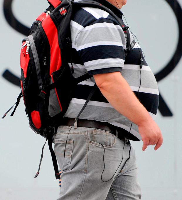 Similar areas in genes are linked to being obese or lonely. Stock picture: PA