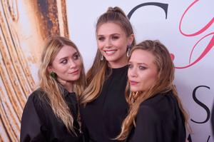 Elizabeth Olsen (center) and Mary-Kate and Ashley Olsen attend the 2016 CFDA Fashion Awards at the Hammerstein Ballroom on June 6, 2016 in New York City.  (Photo by Jamie McCarthy/Getty Images)
