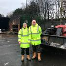 Kenny McAdam and Tony Scanlon, who spent two hours digging through rubbish after a woman realised she had thrown away her mother's life savings by accident Photo credit: West Dunbartonshire Council/PA Wire