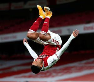 Pierre-Emerick Aubameyang celebrates acrobatically after scoring Arsenal's opening goal against Newcastle. Photo: Getty Images