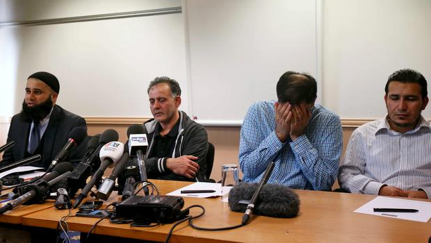 Solicitor Balaal Khan (L-R) sits with Akhtar Iqbal, the husband of Sugra Dawoodman, Mohammed Shoaib, the husband of Khadija Bibi dawood, and a family friend, during a news conference in Bradford, Britain, June 16, 2015. British police said on Tuesday they were hunting for three sisters and their nine children whose family fear they may have travelled to Syria to join a relative believed to be involved in the fighting there. REUTERS/Andrew Yates