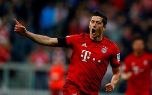 Bayern Munich's Robert Lewandowski reacts after scoring tonight