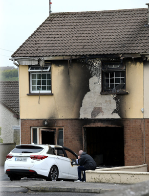 A house and car which were firebombed in the ongoing Drogheda feud
