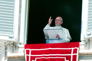 Pope Francis delivers his blessing to faithful during the Angelus noon prayer from his studio window overlooking St. Peter's Square