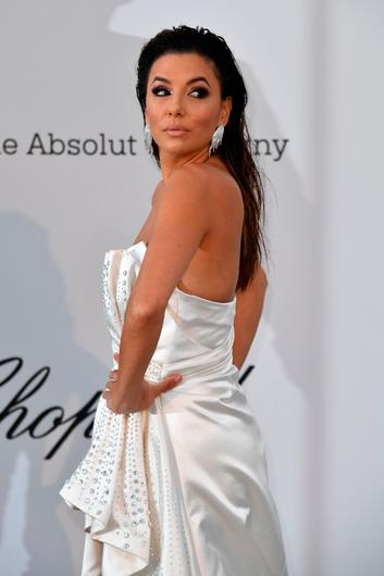 US actress Eva Longoria poses as she arrives on May 23, 2019 for the amfAR 26th Annual Cinema Against AIDS gala at the Hotel du Cap-Eden-Roc in Cap d'Antibes, southern France, on the sidelines of the 72nd Cannes Film Festival. (Photo by Alberto PIZZOLI / AFP)