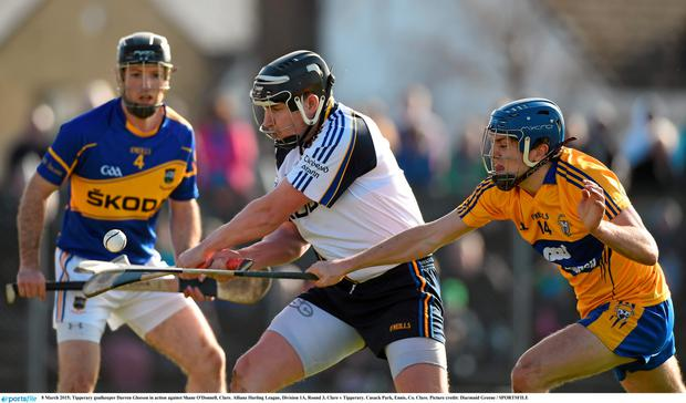 8 March 2015; Tipperary goalkeeper Darren Gleeson in action against Shane O'Donnell, Clare. Allianz Hurling League, Division 1A, Round 3, Clare v Tipperary. Cusack Park, Ennis, Co. Clare. Picture credit: Diarmuid Greene / SPORTSFILE