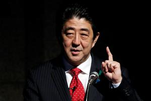 Japan's Prime Minister Shinzo Abe gestures as he gives a keynote address at Japan Summit 2014 hosted by the Economist magazine in Tokyo. Reuters