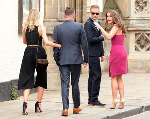 Brooke Vincent and Anthony Cotton (right), make their way to St Mary's Church in Bury St Edmunds, Suffolk, for the wedding of former Coronation Street actress Michelle Keegan to The Only Way Is Essex star Mark Wright.  Yui Mok/PA Wire