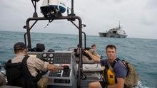 Sailors from the US Navy's USS Fort Worth searching in the Java Sea for  AirAsia Flight QZ8501 make preparations to launch a Tow Fish side scan sonar system from the ship's 11-m rigid hull inflatable boat in a photo released by the US Navy January 4, 2015.  REUTERS/US Navy/Mass Communication Specialist MC2 Antonio P. Turretto Ramos/Handout