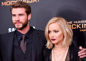 """NEW YORK, NY - NOVEMBER 18:  Liam Hemsworth and Jennifer Lawrence attend """"The Hunger Games: Mockingjay- Part 2"""" premiere at AMC Loews Lincoln Square 13 theater on November 18, 2015 in New York City.  (Photo by Grant Lamos IV/FilmMagic)"""