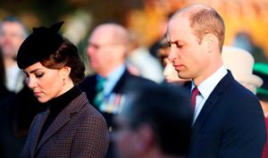 The Duke and Duchess of Cambridge at the Sandringham war memorial cross as the Queen and the Duke of Edinburgh lay wreaths to mark the 100th anniversary of the end of the doomed First World War Gallipoli campaign