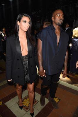 Kim Kardashian and Kanye West attend the Lanvin show as part of the Paris Fashion Week Womenswear Spring/Summer 2015 on September 25, 2014 in Paris, France.  (Photo by Pascal Le Segretain/Getty Images)