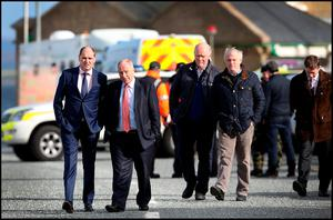 Minister of State at the Departments of An Taoiseach and Defence with Special Responsibility for Defence Paul Kehoe TD and Minister of State for Regional Economic Development Michael Ring TD arrive at Blacksod Bay in Co Mayo during the seach and recovery of Rescue 116. Pic Steve Humphreys