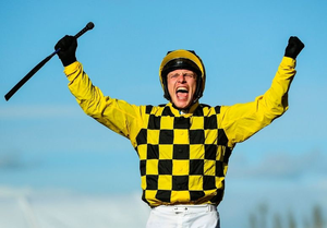DELIGHT: Jockey Paul Townend celebrates after winning the Gold Cup on Al Boum Photo at the Cheltenham Racing Festival in March. Photo by Harry Murphy/Sportsfile