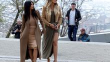 Kim Kardashian, left and sister Khloe Kardashian walk in Victory Park while filming in Yerevan, Armenia, Thursday, April 9, 2015. The Kardashian family arrived on Wednesday in the capital of their ancestral Armenia and earlier on Thursday met with Armenian Prime Minister Hovik Abrahamyan (AP photo/Artur Harutyunyan, PAN Photo)