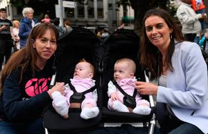 Pauline Gallagher (right) with her daughters Amelia and Alana after seeing Pope Francis on College Green, Dublin, as he travels in the Popemobile during his visit to Ireland. Photo: Joe Giddens/PA Wire