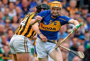 Tipperary's Lar Corbett fights to get past a challenge from Jackie Tyrell of Kilkenny during the 2014 All-Ireland hurling final at Croke Park. Photo: Piaras O Midheach / SPORTSFILE
