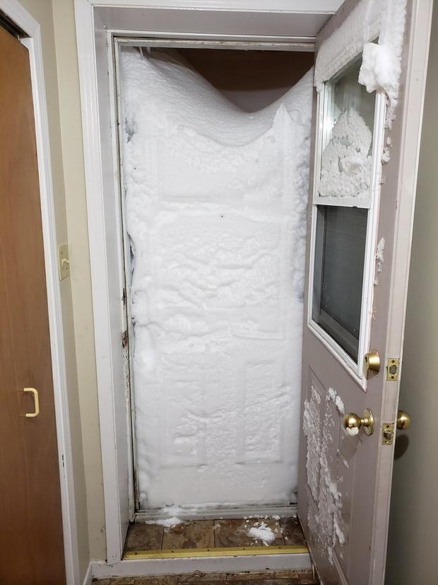 Snow blocks the entrance to an apartment in St Johns, Newfoundland, Canada, January 17, 2020, in this photo obtained from social media, @etrevorpowell/via REUTERS THIS IMAGE HAS BEEN SUPPLIED BY A THIRD PARTY. MANDATORY CREDIT. NO RESALES. NO ARCHIVES.