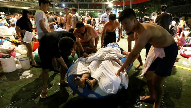 People carry an injured victim from an accidental explosion during a music concert at the Formosa Water Park in New Taipei City, Taiwan  REUTERS/Wu Chia