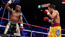 Floyd Mayweather Jr., left, celebrates during his welterweight title fight against Manny Pacquiao