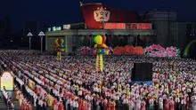 North Koreans performers wait to dance during celebrations to mark the 100th birth anniversary of the country's founding leader Kim Il-Sung, in Pyongyang on April 16, 2012.
