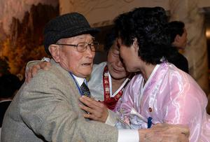 South Korean Ryu Young-Shik (L),92, meets with his North Korean relatives during a family reunion after being separated for 60 years