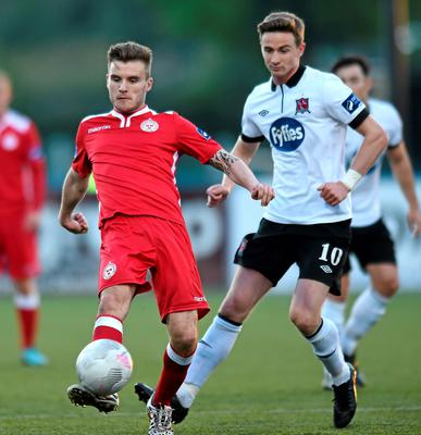 Shelbourne's Colm Crowe in action against Ronan Finn of Dundalk