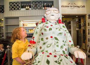 04.09.14         Limerick City gears up for Royal de Luxe. The Hook & Ladder Cafe, have created a giant cake of Granny helping to raise funds for Pieta House.  Checking the giant cake out in Hook & Ladder was Ava Fox, 3, Larkins Cross, Co. Clare. Picture: Alan Place/FusionShooters.