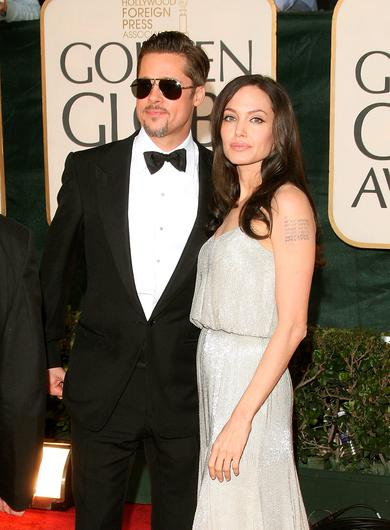 Actors Brad Pitt and Angelina Jolie arrive at the 66th Annual Golden Globe Awards held at the Beverly Hilton Hotel on January 11, 2009 in Beverly Hills, California.  (Photo by Jason Merritt/Getty Images)